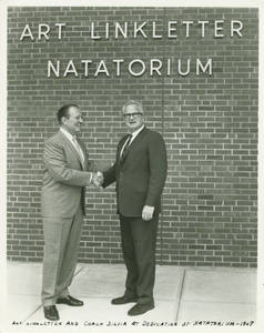 Art Linkletter and Charles Silvia Shaking Hands in front of the Linkletter Natatorium, 1967