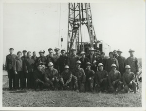 Shirley Graham and David Du Bois standing with a group of oil workers