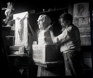 Carlo Abate, at work sculpting a marble bust of Thomas Edison