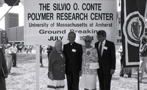 Corinne Conte with priest and two other unidentified people
