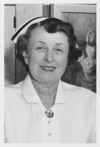 Mary Ann Maher in nurse's uniform and cap