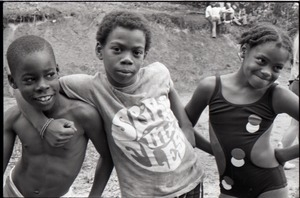 Three African American (possibly at summer camp), one wearing a Spirit in Flesh t-shirt