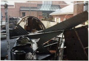 The dismantled parts to the back room of Munson Annex are piled up by the quonset hut