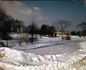 View of snow on campus, with Machmer Hall, Student Union, and Goessmann Laboratory (l. to r.) in background