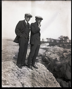George S. Akasu (left) and unidentified man standing on a rocky shore