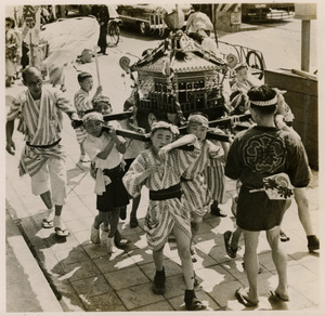 Boys carrying a float in a matsuri procession