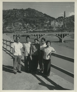 Shirley Graham Du Bois with two unidentified men and two women in front of the Provincial Road Bridge in Yan'an, China