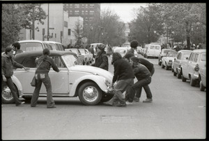 May Day concert and demonstrations: protesters moving Volkswagen Beetle into road