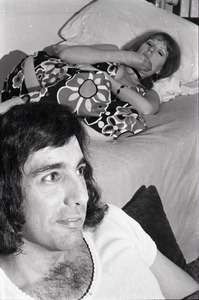 Charles Laquidara at home: Laquidara with unidentified woman in bed