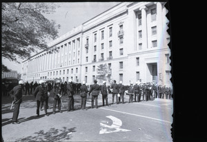 May Day demonstrations and street actions by the Justice Department: line of police in front of Department of Justice building