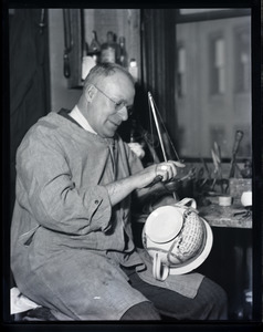 Nathan S. Hill, china repairer, working on a transferware chamber pot