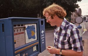 Man buying a ticket for public transportation in Switzerland