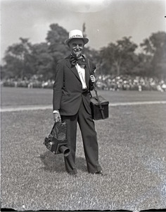 Franklin I. Jordan, photographer, wearing a festive hat and tie, with cameras