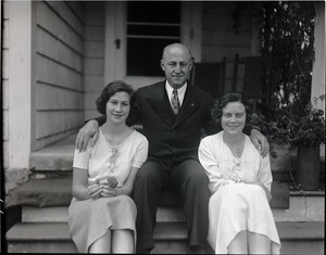 Alfred W. Ingalls and family, seated on the steps of their new home