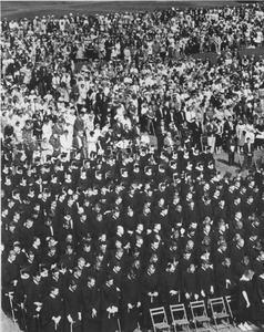 Audience and graduates during the Centennial commencement