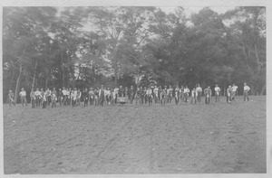 Class of 1882 lined up on a plowed field