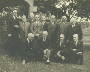 Class of 1892 posing outside at their 50th reunion. Back row: Faneuf, Rogers, Knight, Williams, Lyman, Willard, Field, and Toylor. Front row: Emerson, Boynton, Holland