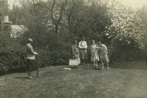 Students surveying on the campus lawn
