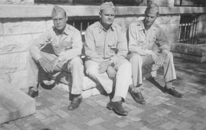 Albert Burgess, Randolph Barrows and Cloyes Gleason sitting outside