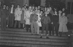 Class of 1944 members gather on the steps of a campus building