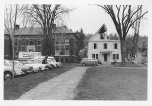 Demolition of the Mathematics Building near Fernald Hall; view from the front with Insectary gone and Volkswagen microbus parked in front