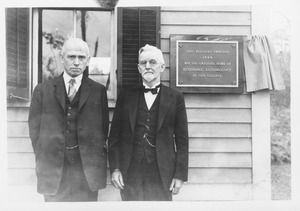 Jewell B. Knight (class of 1892) and Ephraim P. Felt (class of 1891) at the Insectary, with plaque reading 'This building erected 1889 was the original home of Economic Entomology at this college'
