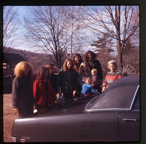 Group of commune members at Montague Farm Commune, including Charles Light and Nina Keller (far left), Janice Frey (with baby), and Tony Mathews (behind Frey's right shoulder)
