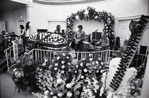 Duane Allman's funeral: musicians setting up with Duane Allman's casket in foreground, from left: Delaney Bramlett, Barry Oakley, Jaimoe, Dickey Betts, Butch Trucks, and Thom Doucette