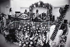 Duane Allman's funeral: musicians setting up with Duane Allman's casket in foreground, from left: Barry Oakley, Jaimoe, Delaney Bramlett, Dickey Betts, Butch Trucks, and Thom Doucette