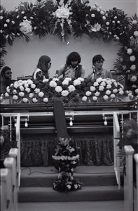Duane Allman's funeral: Allman Brothers Band performing, from left, Jaimoe, Barry Oakley, Delaney Bramlett, and Dickey Betts, with Allman's casket in the foreground