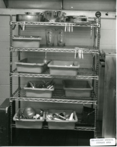 Photograph of a utensil storage unit with shelves, [1982-1983].
