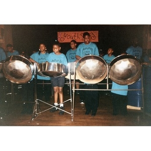 African American youth playing steel drums on stage at the Jorge Hernandez Cultural Center.
