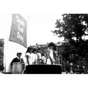 Children on an outdoor stage during an event on South End Day.