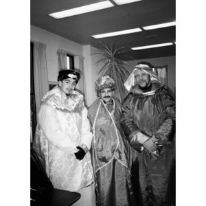 Three men dressed as the Three Kings, or Magi, pose for a group portrait in the Inquilinos Boricuas en Acción offices.