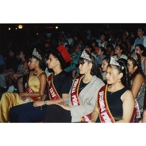 The Queen, King, and Princesses of the Festival Betances sitting in the audience during the beauty contest.