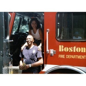 Woman sitting in the driver's seat of a Boston Fire Department truck that is parked at the 1999 Festival Betances.