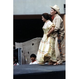 Couple performing a traditional folk dance on the outdoor stage at Festival Betances.