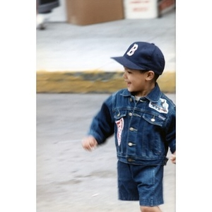 Portrait of a young Festival Betances attendee in a Thomas the Tank Engine jean jacket.