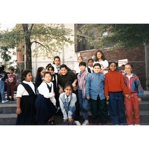 Group portrait of elementary school children standing outside in a park.