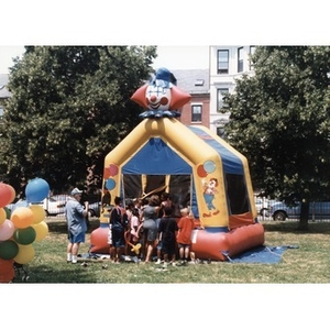 Children waiting to enter a bounce house at Festival Betances.