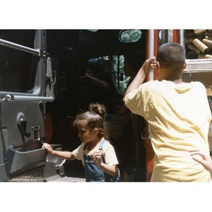Children exploring a fire truck at Festival Betances.