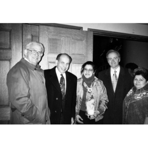 Clara Garcia and Carmen Colombani with three unidentified men in suits.