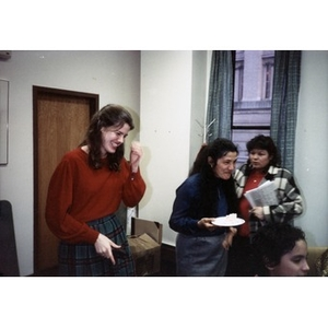 Clara Garcia and other staff members laughing during an office party.