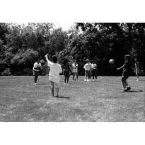 Inquilinos Boricuas en Acción employees playing soccer in a field during a staff outing.