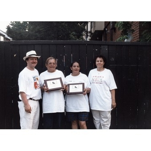 David Cortiella and Carmen Cotto (?) stand with runner up winners in the dominoes competition at Festival Betances.
