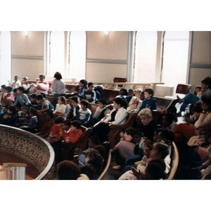 Children in the balcony area of the Jorge Hernandez Cultural Center watching a performance.
