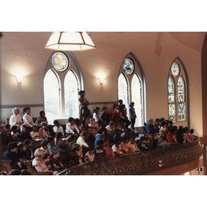 Audience of school children watches a performance from the balcony at the Jorge Hernandez Cultural Center.