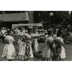 Teenage girls in folk costumes get ready to dance in the plaza at Festival Betances.
