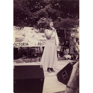 Young woman singing on the outdoor stage at Festival Betances.