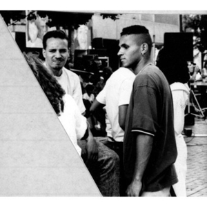 Two unidentified young men form part of the crowd in the Plaza Betances for a special event.